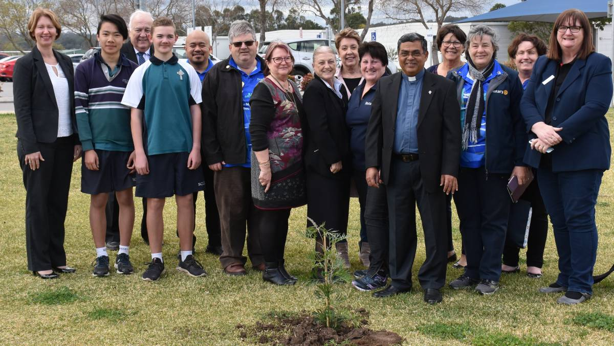 TREE PLANTING: Members of the Rotary of Singleton Sunrise welcomed special guests, including their District Governor Mr Graeme Hooper and his wife Sue, to the annual tree planting ceremony held at St Catherine's Catholic College on Tuesday afternoon.